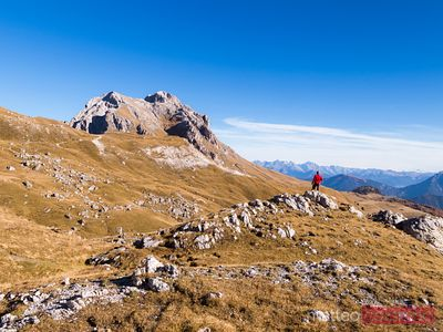 Aerial drone view of hiker in the mountains, Dolomites
