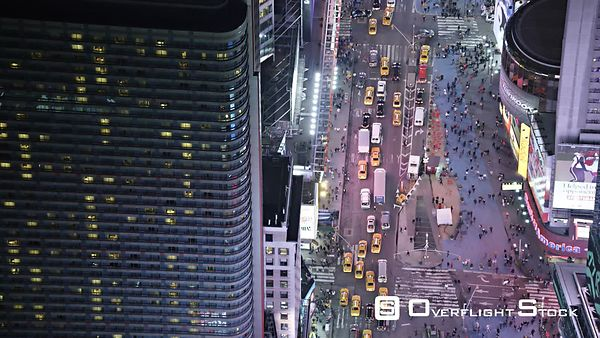 Tilt-up, flying over Times Square at night.