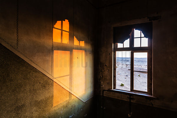 Last Light Shining Through Abandoned House