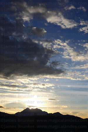 Dramatic clouds over Mt Illimani at sunrise, Cordillera Real, Bolivia