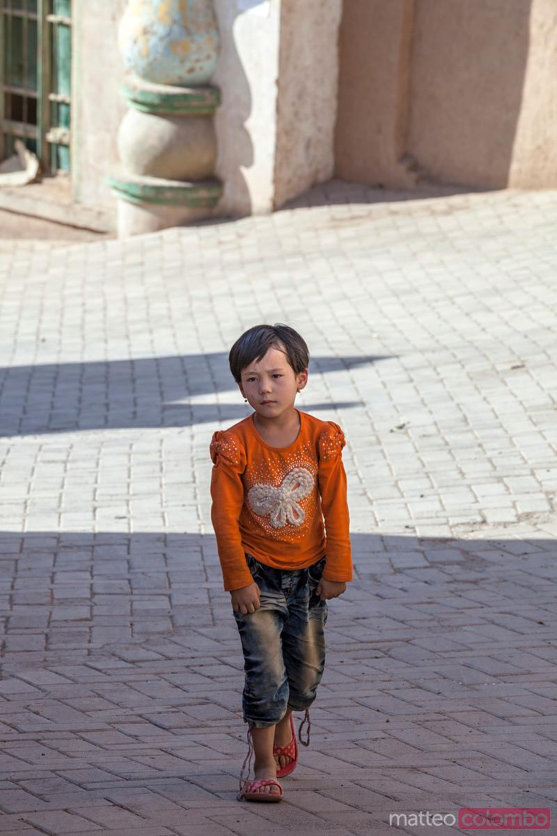 Uyghur child in the street of village, Xinjiang, China