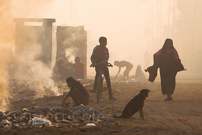 Air pollution from open fires and smelters near Bantala, Kolkata, India.