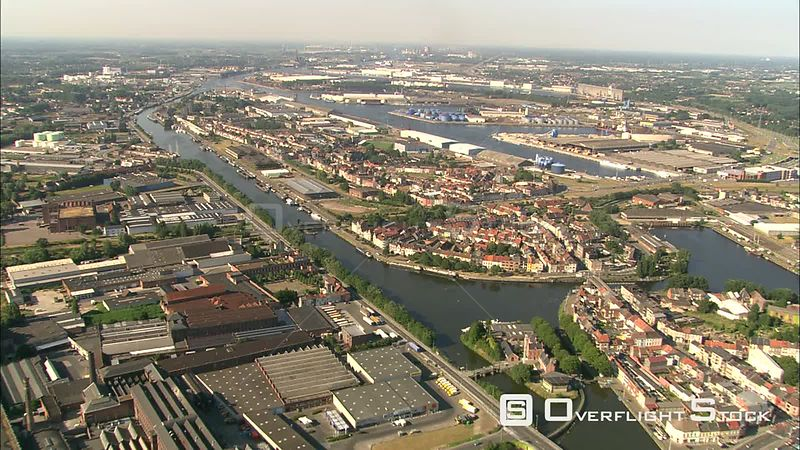 Flying over river and industrial area in Ghent, Belgium