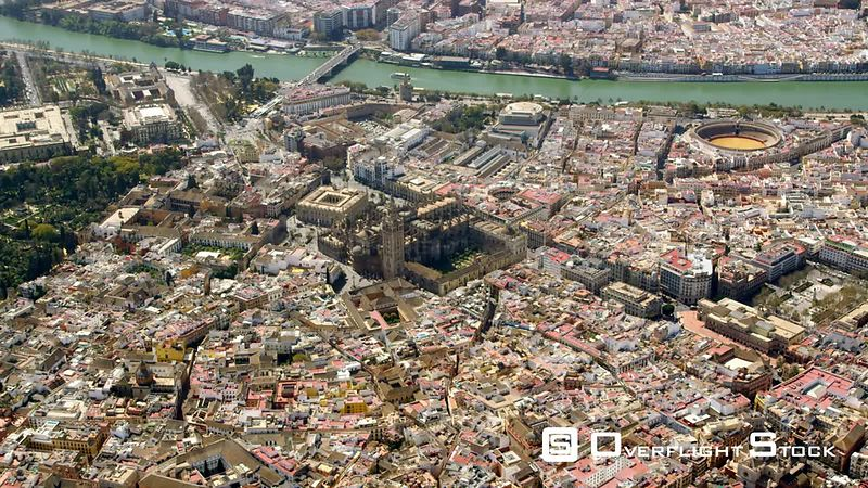 Circling Aerial View of the Historic Center of Seville With Cathedral and La Giralda in Center, Bullring la Meastranza to the...