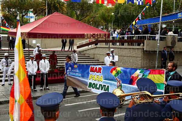 Members of the Economics and Public Finances Ministry parade past the remains of Eduardo Abaroa, Plaza Avaroa, La Paz, Bolivia
