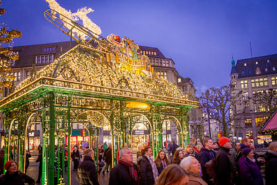 Christmas Market ornate Structure and people standing Gazing Skywards