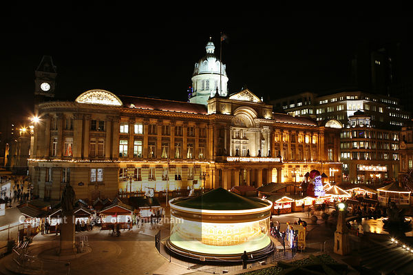 Birmingham City Centre. The Council House in Victoria Square at Christmas time, along with fair ground rides.