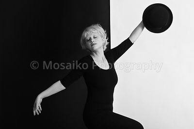 Portrait of young blond woman - circus pantomime posing on black and white background - Black and White Photography