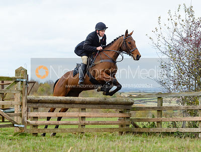 Russell Nearn jumping a hunt jump at Stone Lodge. The Cottesmore Hunt at Tilton