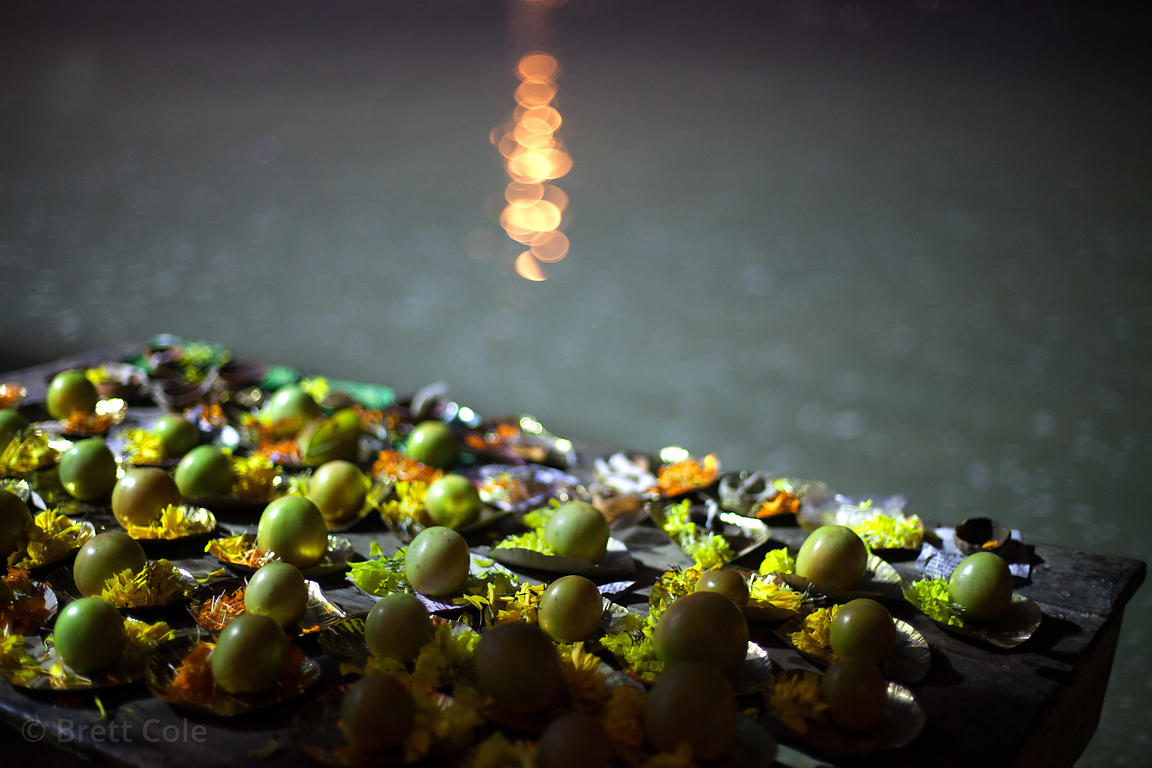 A table with apples used in prayer rituals sits in the waters of the Bay of Bangal on the beach at the Gangasagar Mela, Sagar...