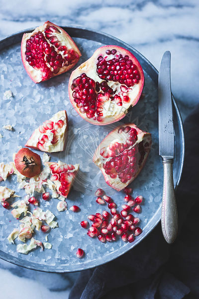 Pomegranate and seeds on a tray