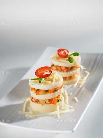 Palm heart Pupunha Bruschetta with diagonal dish isolated on white background