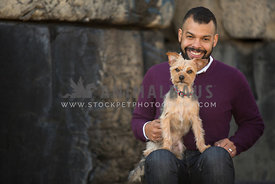 man smiling with small dog