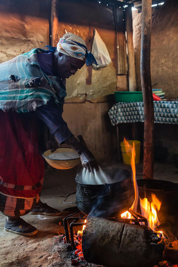 Woman Preparing Maize Meal in Potjie Pot