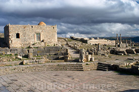 Looking east from the Square of the Winds. Note the small mosque built ont he ruins of the of the temple to Augustus fortune,...