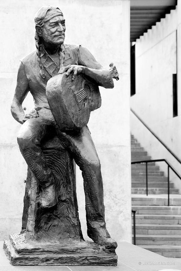 WILLIE NELSON SCULPTURE DOWNTOWN AUSTIN TEXAS BLACK AND WHITE VERTICAL