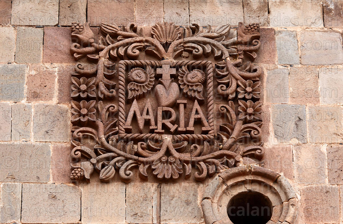 Maria carving with sacred heart symbol on tower of Puno cathedral , Peru