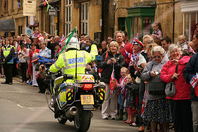 Police Motorcyclist Waving to Crowd at Olympic Torch Relay