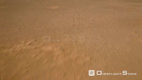 Aerial wide angle shot sandy desert landscape then over side to mountains in background Botswana