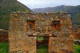 Building with unusual recessed trapezoid window in Inca site of Pumamarca, Patacancha Valley, Cusco Region, Peru