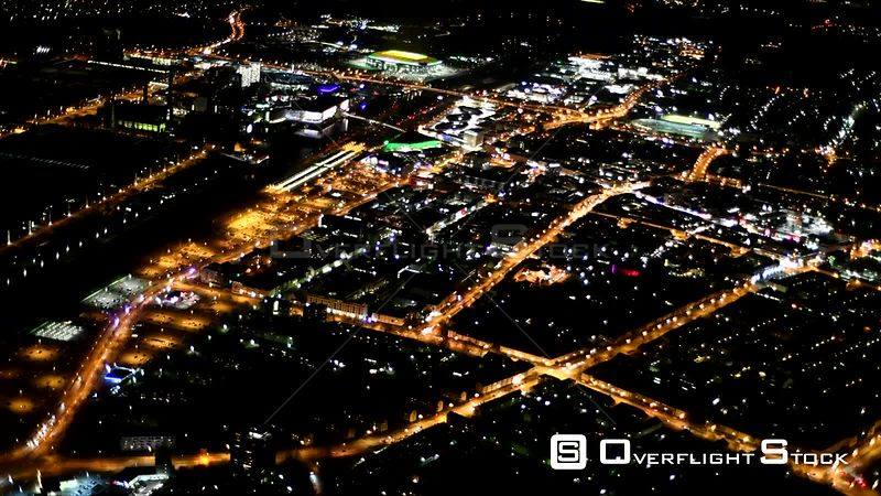 Night aerial video City view of the downtown area with the shopping mall City-Galerie in Wolfsburg in the state of Lower Saxony, Germany