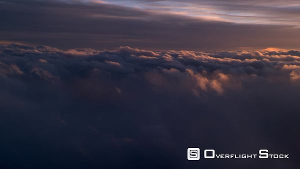 Evening flight through clouds, passenger POV