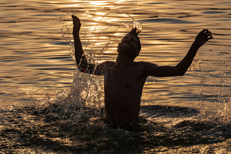 Man Taking a Dip in the Ganges River