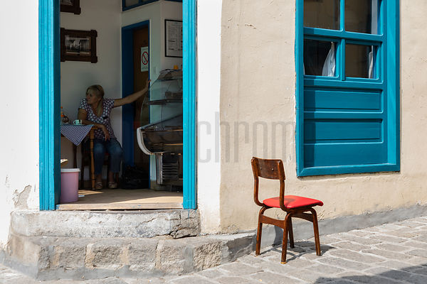 Red Chair and Blue Shutters