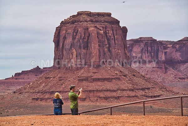 2 Tourists Taking Photos- Monument Valley-  Navajo Nation On The Arizona/Utah Border