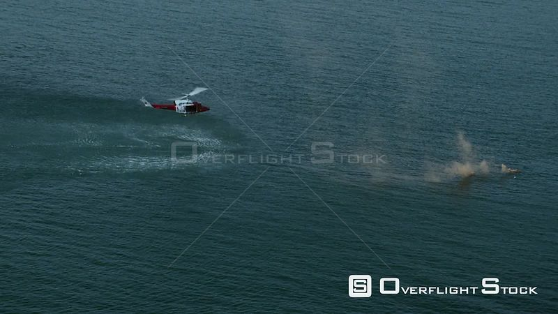 Aerial of a rescue helicopter approaching smoke from a flare in the sea Cape Town Western Cape South Africa