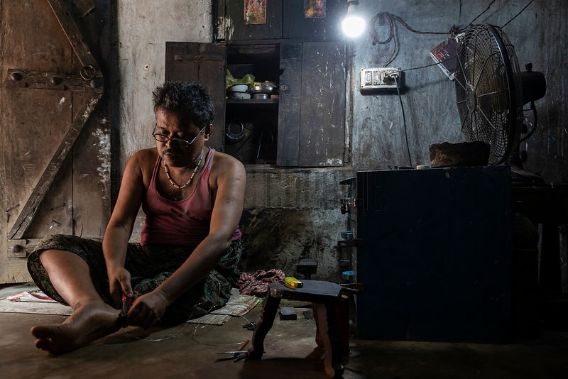 A Jeweller Stretches Wire in his Workshop at the Craftsman Village of Raghrajpur