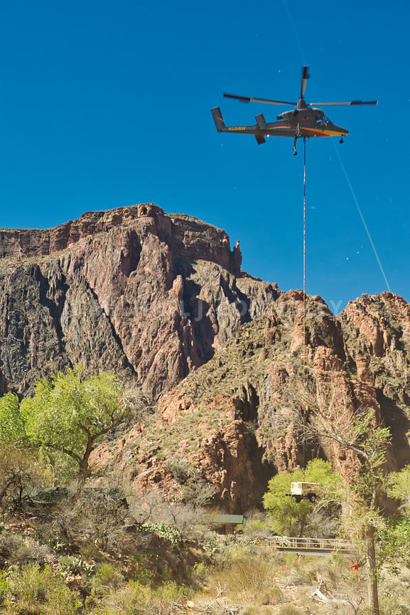 Helicopter Airdropping An Air Compressor At Phantom Ranch-Grand Canyon