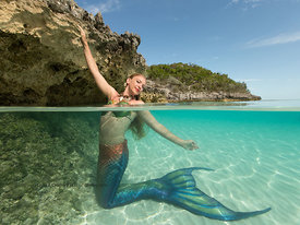 Mermaid Rachel Smith, Chief of Mermaids at the Dive Bar, Sacramento, CA in shallow water, Exuma Cays, Bahamas Islands during ...