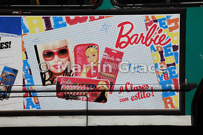 Close-up of coach (bus) in Buenos Aires, Argentina, with advertisement for Barbie and Hot Wheels