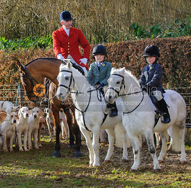 Young followers with huntsman Andrew Osborne MFH - The Cottesmore Hunt at Ashwell Grange 9/12