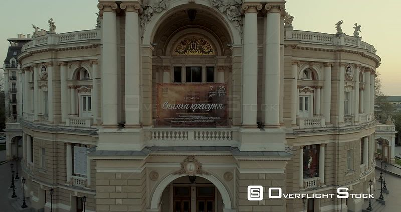 Aerial camera flies slowly back from the centre of the Odessa Opera Theatre to reveal all building. Shot at dawn  Ukraine