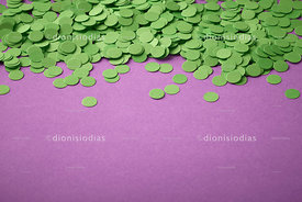 Carnival background with green confetti on violet background