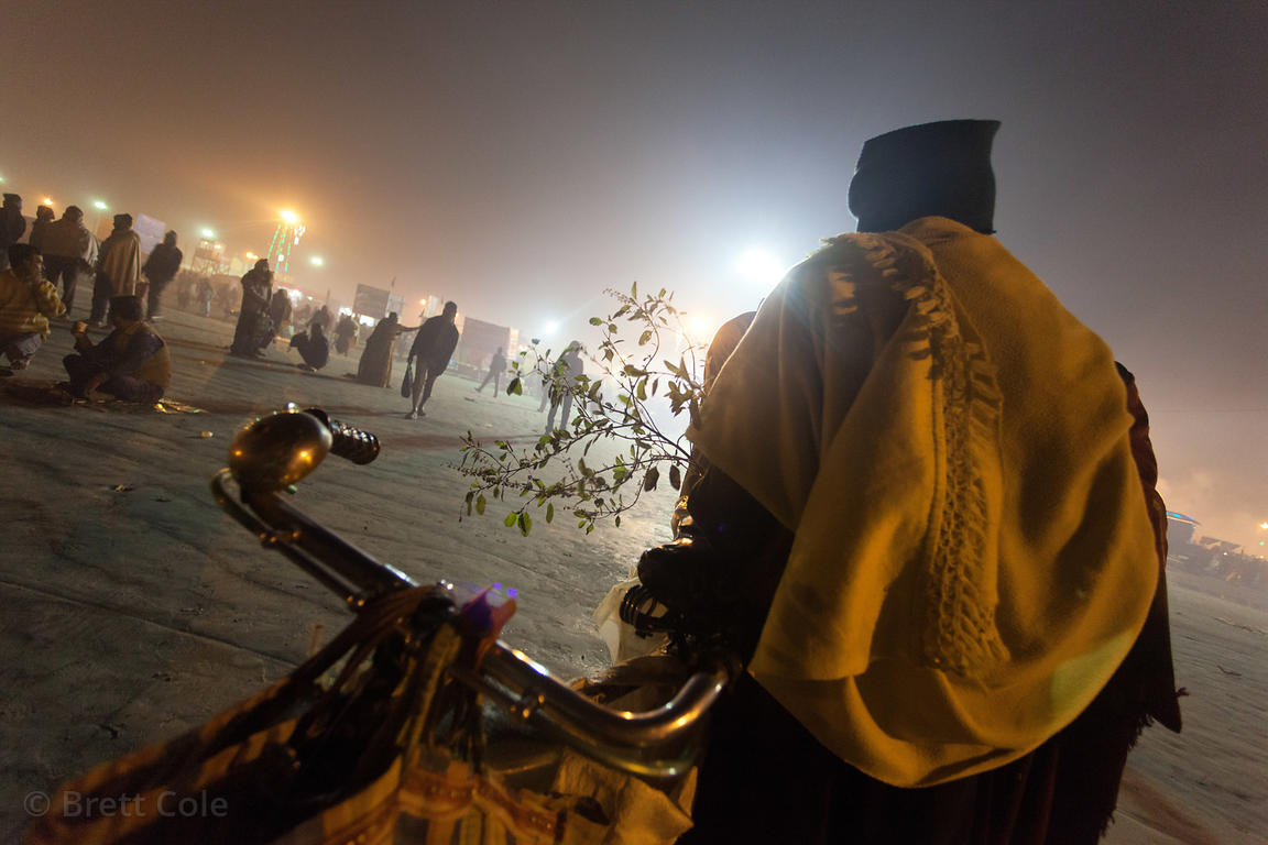 Night scene on the beach at the Gangasagar Mela, Sagar Island, India. Gangasagar is a Hindu pilgrimage to Sagar Island, where...