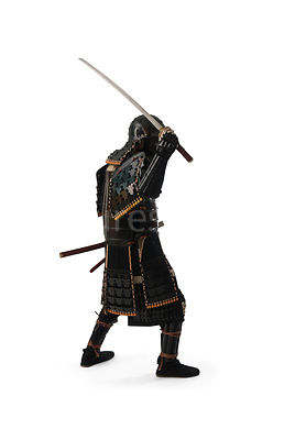 A silouette of a Samurai warrior with his sword in the air - shot from eye-level.