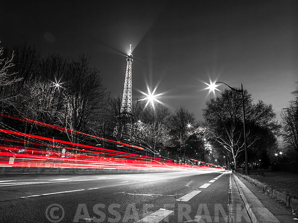 Strip lights on a road next to the Eiffel tower