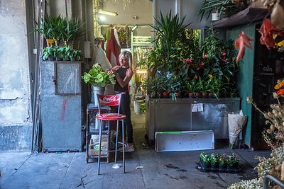 A Florist Arranges A Display Of Flowers In The Mercato Orientale