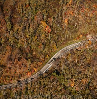 Aerial photograph of a curvy road in the mountains of West Virginia with