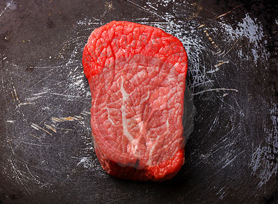 Raw fresh marbled meat Steak on dark metal background