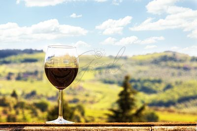 Glass of Wine on a Ledge Overlooking Vineyards in Chianti Italy