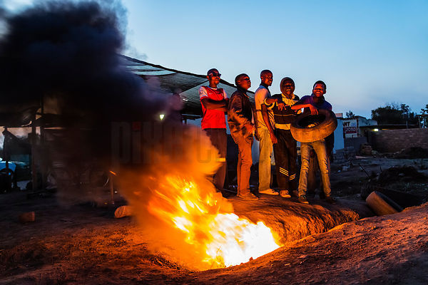 Boys Burning Tyres for Warmth