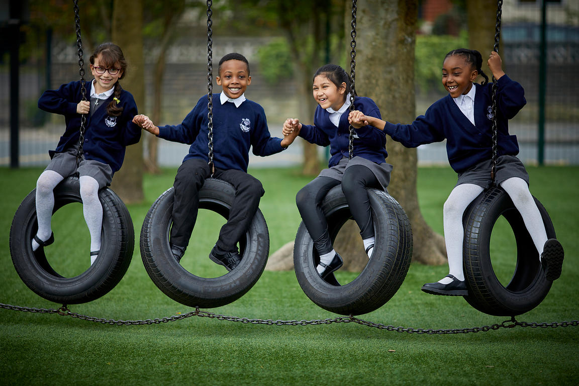 Children playing on tyres