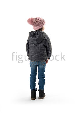 A Figurestock image of a little girl in a bobble hat facing away – shot from eye level.