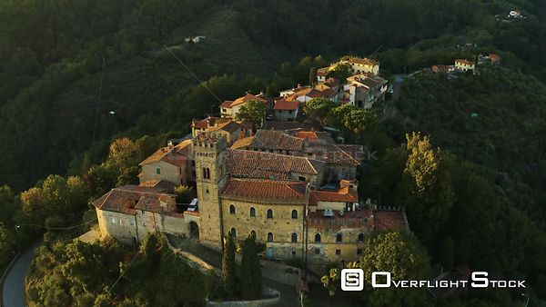 Aerial, an ancient small perched hamlet on sunset in Tuscany, Italy