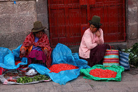 Ladies selling ñucchu flowers for Easter in market , Cusco , Peru