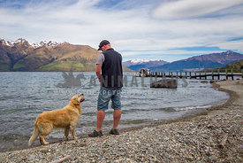 man enjoying fishing trip with his dog